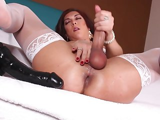 Kinky transvestite in white stockings plays with anal gewgaw